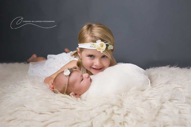 Newborn baby with her older sister