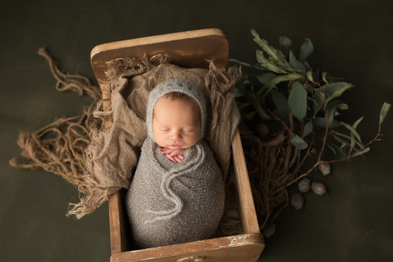 Perth Newborn Photographer takes cute pics of babies bundled up in props
