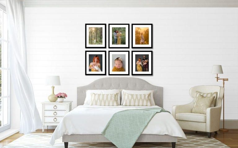Display of newborn and maternity photos in black frames