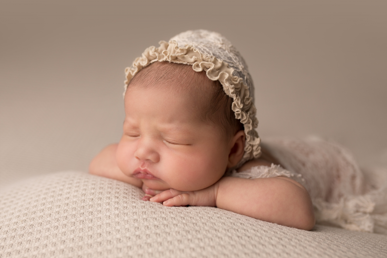 Newborn posing face forward