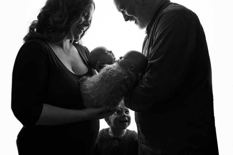 family photo in black and white with twin baby girls