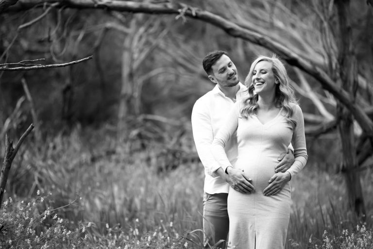Maternity photo of couple laughing